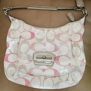 Cream and pink Coach purse